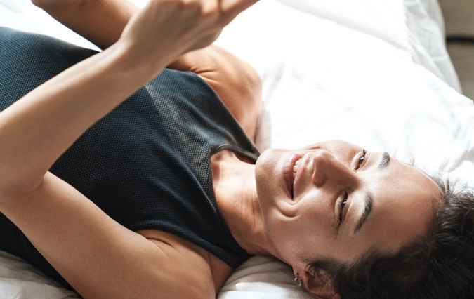 Laying woman with phone